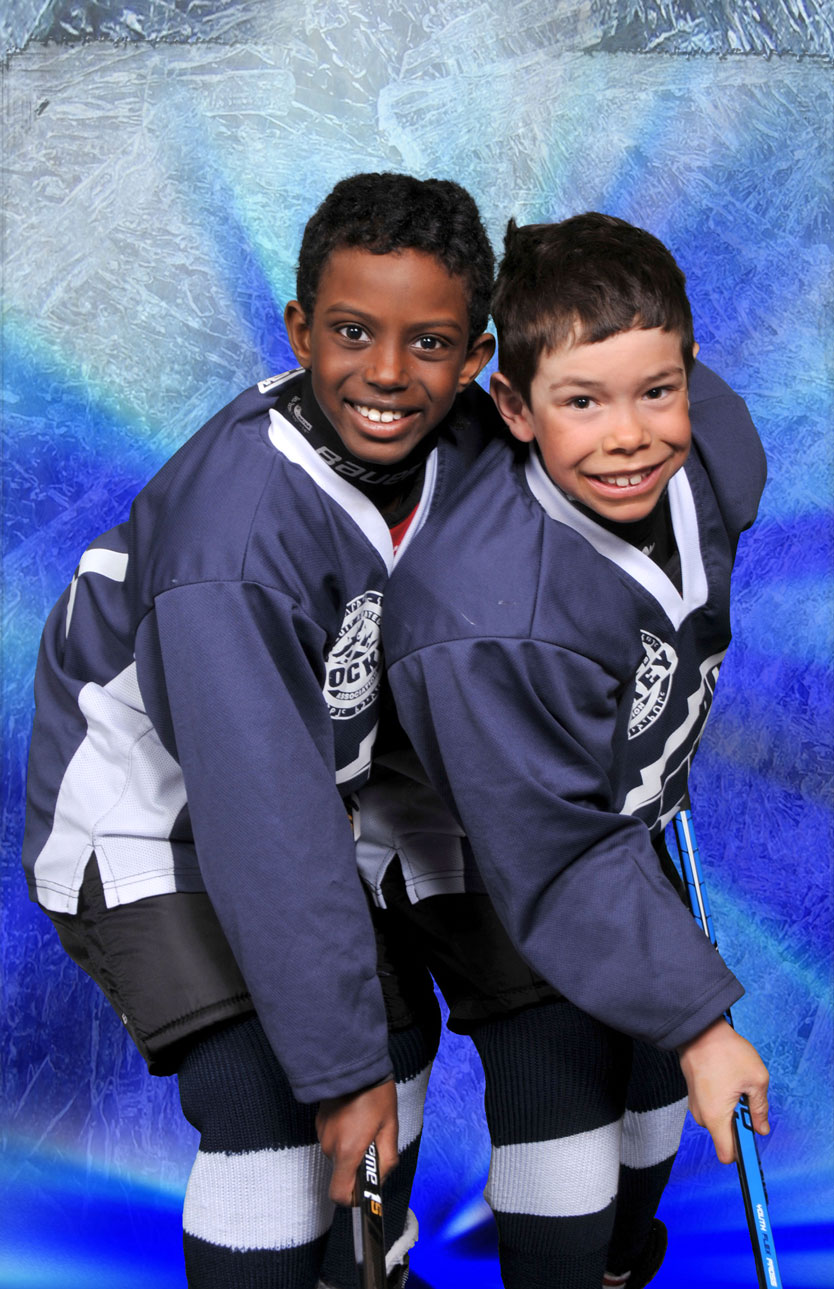 two boys posing in their hockey gear