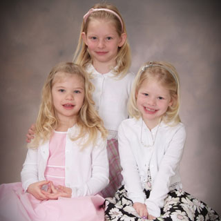 Portrait of 3 little girls in studio