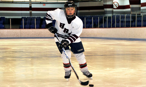 Young hockey player skating
