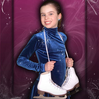 Young girl posing with ice-skates