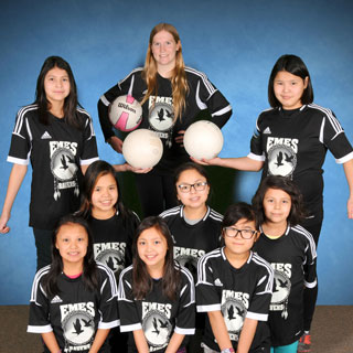 Group portrait of young female volleyball team