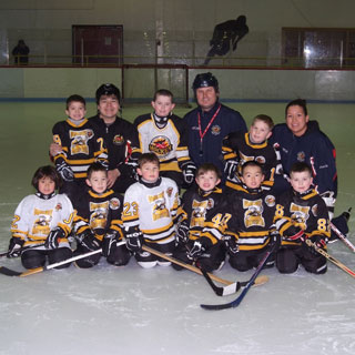 Group portrait of youth hockey team on ice